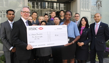 Cheval Residences presenting their cheque for £1055 to Sotonye Dagogo