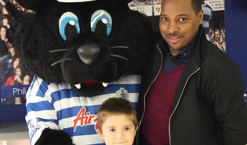 Ex QPR player Andrew Impey with mascot Jude and a young event attendee
